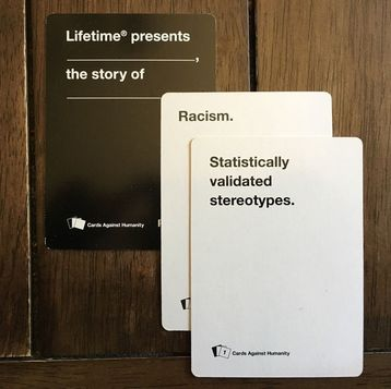 Pictured: 3 cards against humanity cards that when played together read,